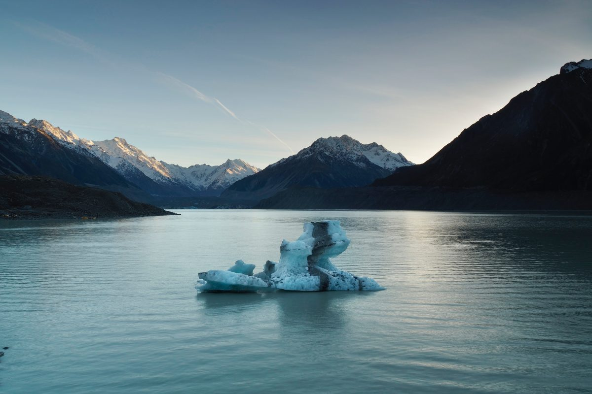 An iceberg floats on Tasman Lake in Mount Cook National Park, New Zealand