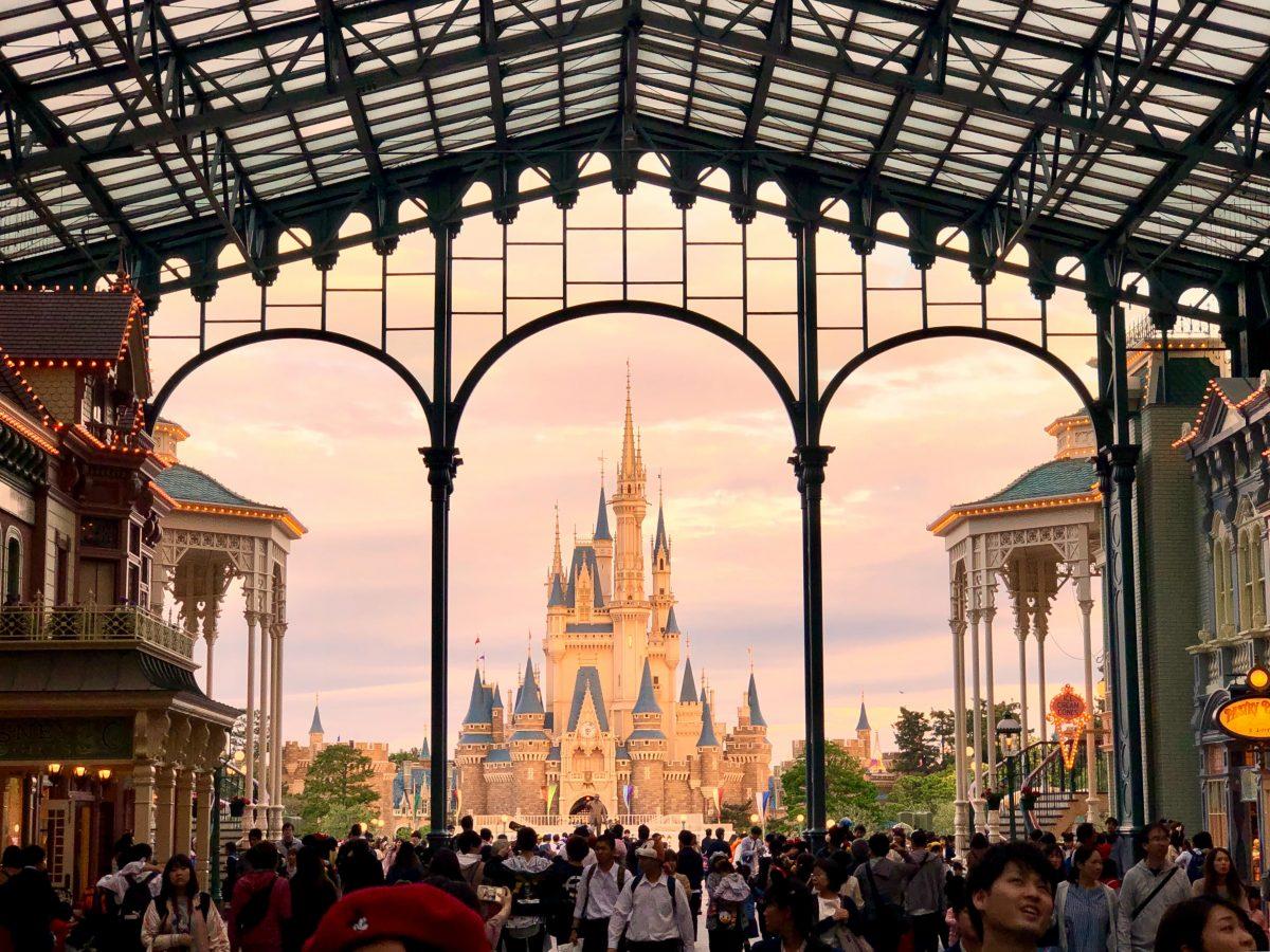 A view of Cinderella's castle at sunset in Tokyo Disneyland, Tokyo, Japan