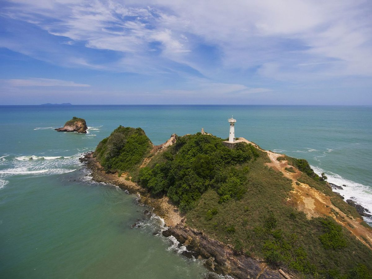 Aerial shot of a lighthouse on an island in Mu Koh Lanta National Park