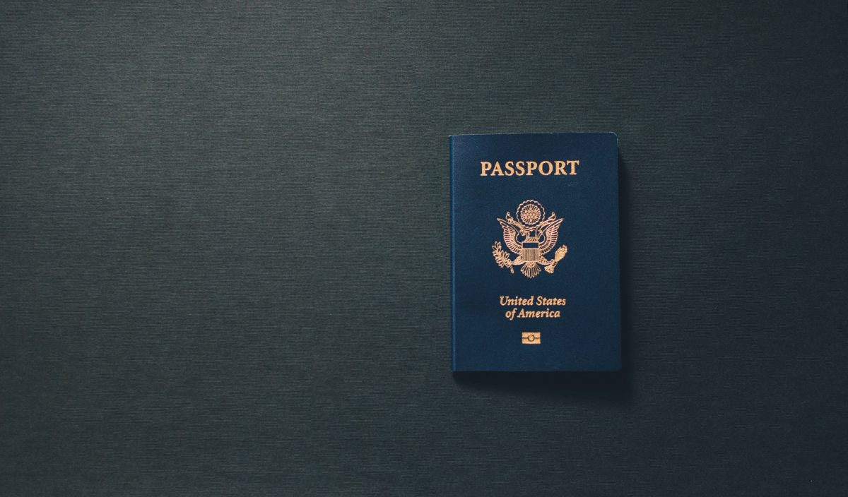 Photo of a Blue United States of America Passport on a dark grey surface