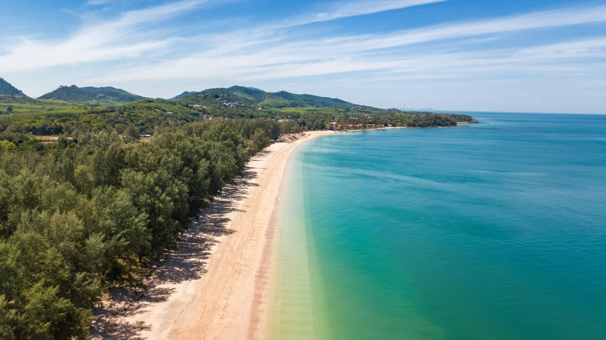Aerial drone view of white sand tropical beach and Andaman sea from above, Koh Lanta island, Thailand