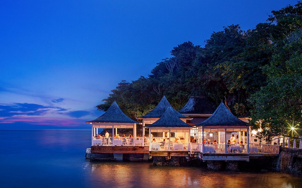 Couples Tower Isle Resort shines brightly during the evening as visitors dine.