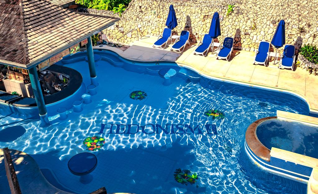 Hedonism II Negril Jamaica adults only clothing optional resort with an outdoor pool and pool bar.