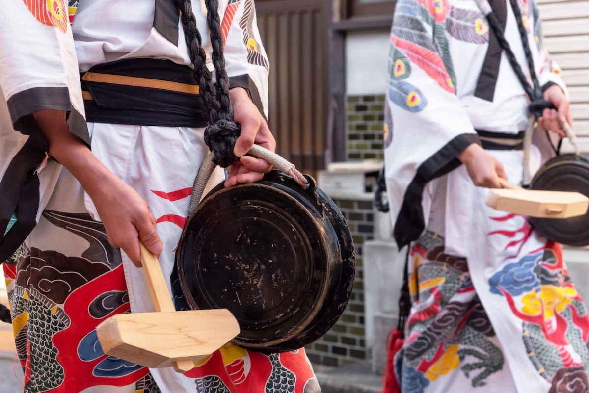 Full traditional Japanese attire with local drum during a parade in Shibuya