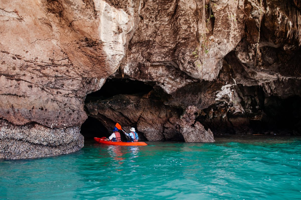 Kayak excursion in sea cave of Koh Talabeng in Koh Lanta, Thailand.