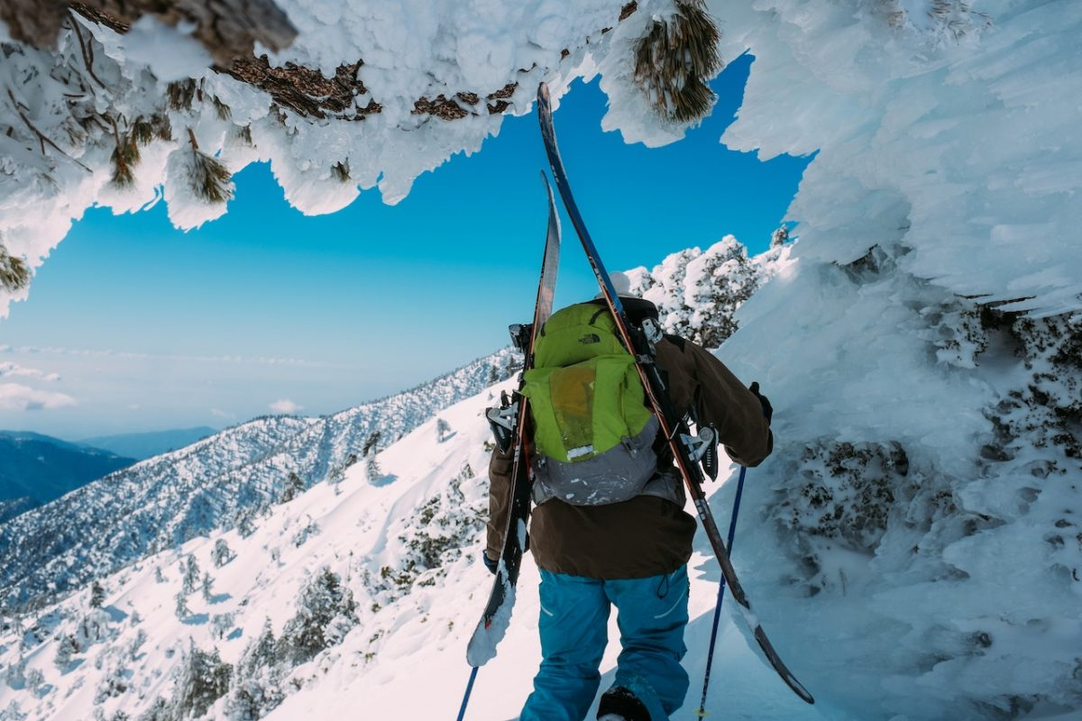 A man snowshoeing in Mount Baldy during winter