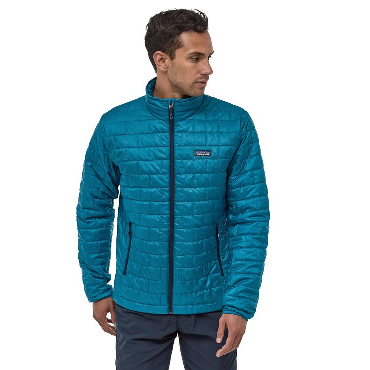 Man wearing teal Patagonia Nano Puff jacket