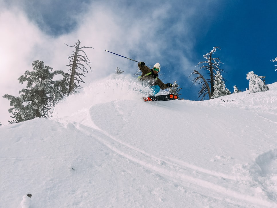 a man skiing down a snowy mountain slope