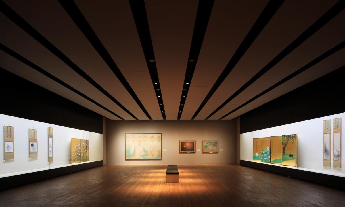 a big room inside the Yamatane Museum of Art showcasing different artworks