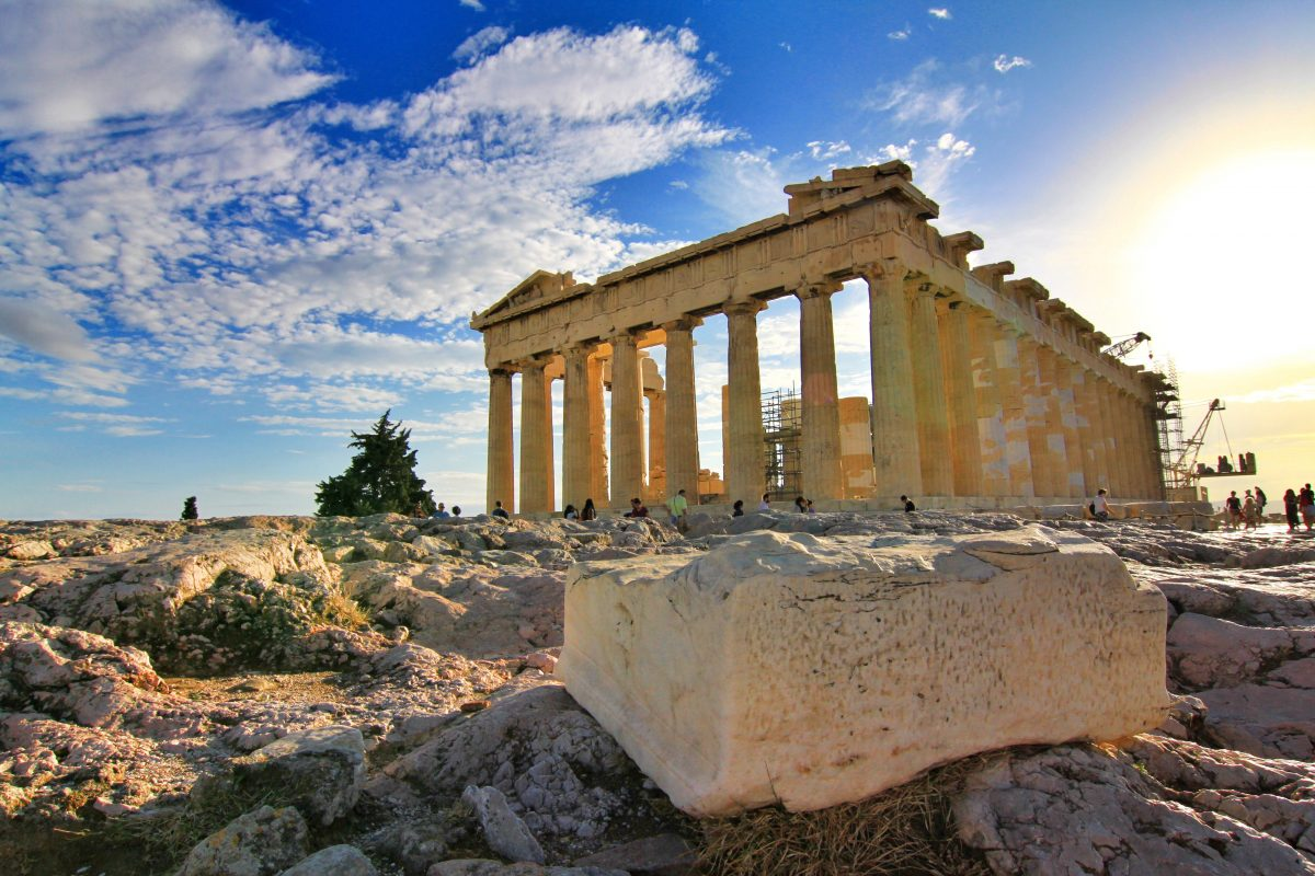 Tourists gather around the Parthenon in Athens, Greece