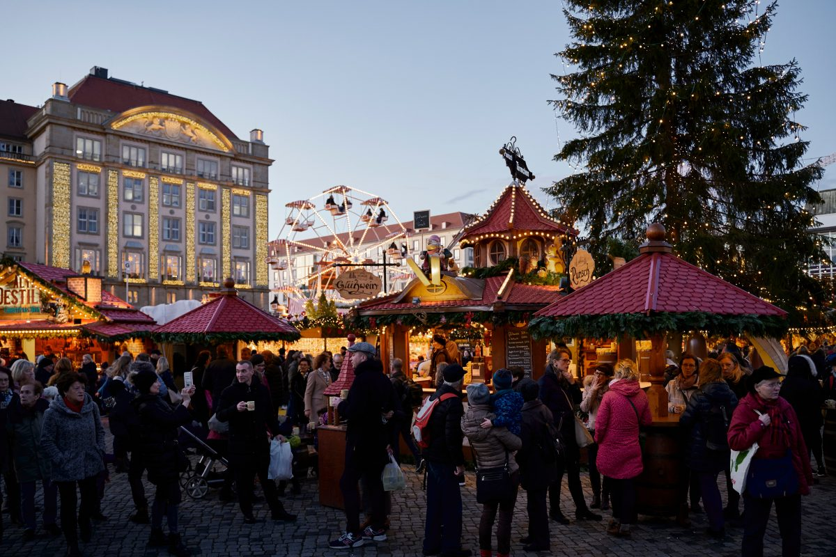 People walking through the Dresden Christmas market in Dresden, Germany