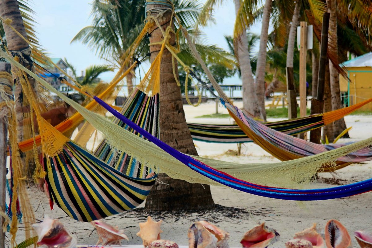 Colorful hammocks hanged together in Placencia, Belize