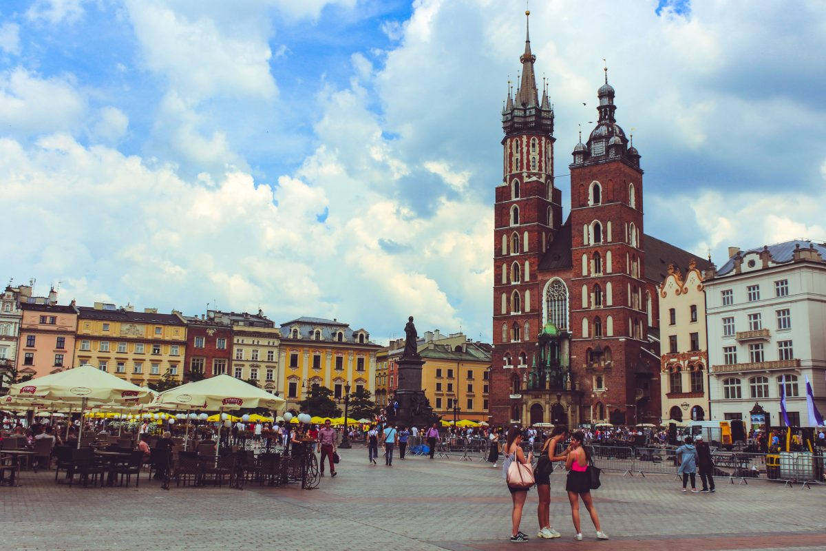 People walking and hanging out at Main Market Square in Krakow, Poland