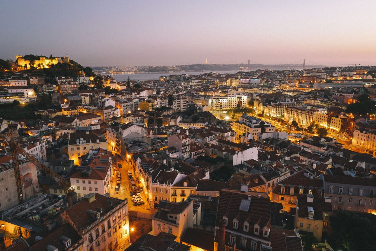An aerial nighttime shot of the beautiful city of Lisbon, Portugal
