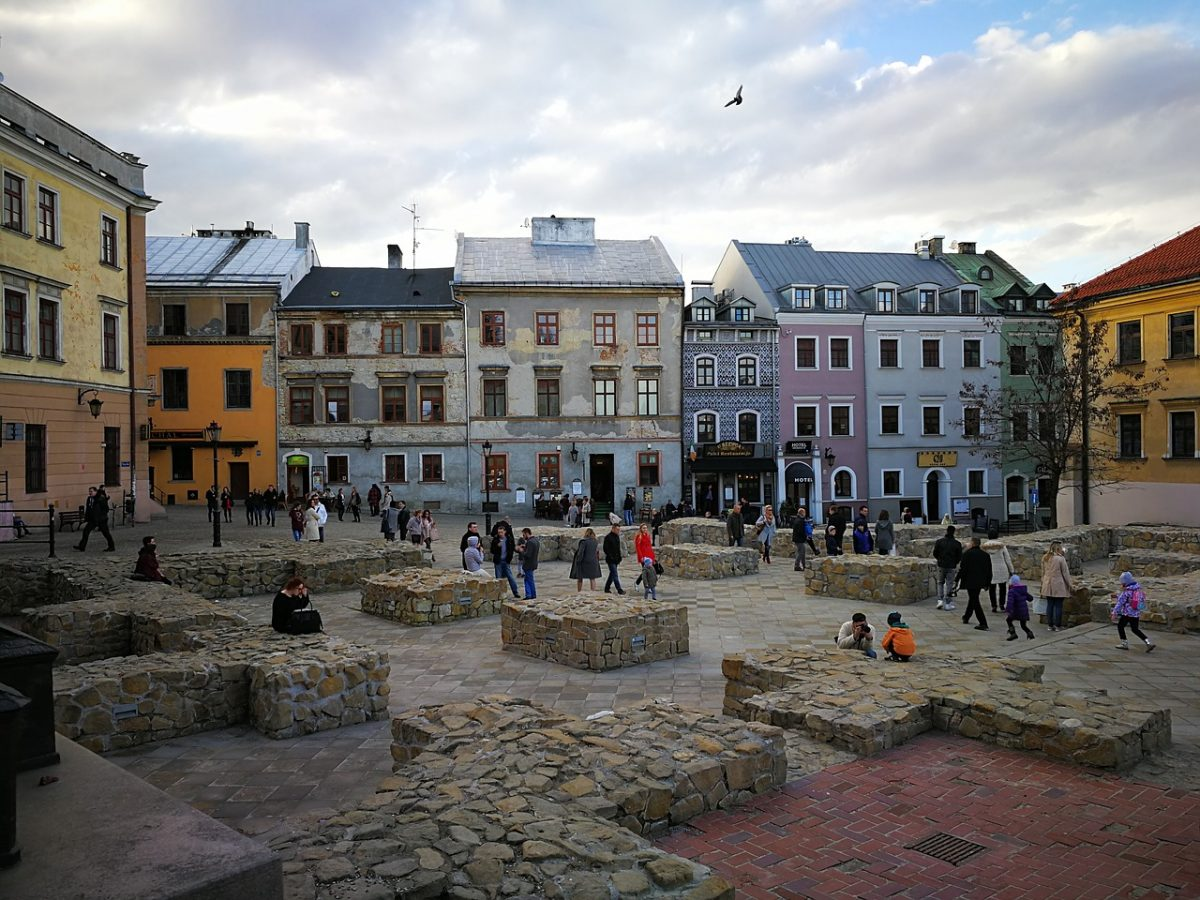 People walking and hanging out in Lublin's Old Town in Poland