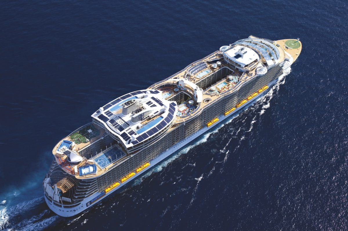 An aerial view of Bliss Cruise's RCI Oasis of the Seas ship at sea