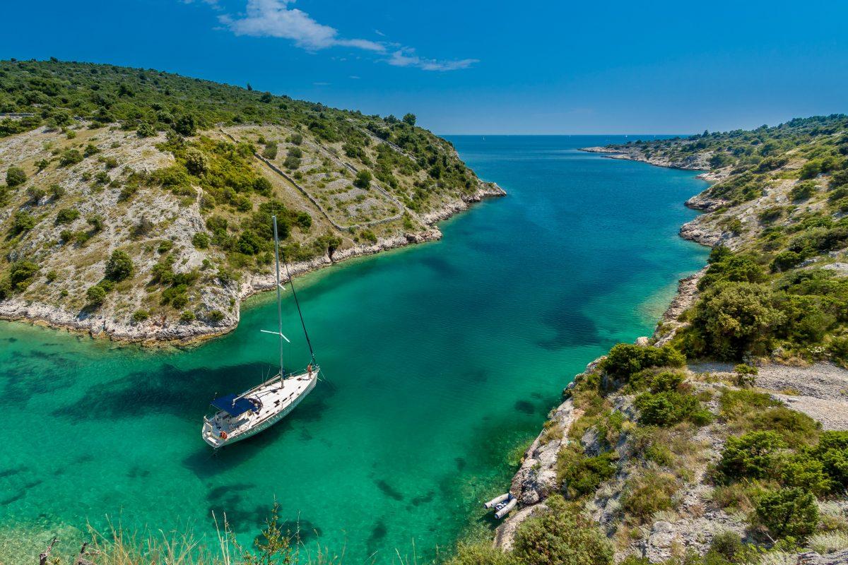 A sailing yacht passes through Trogir, Croatia