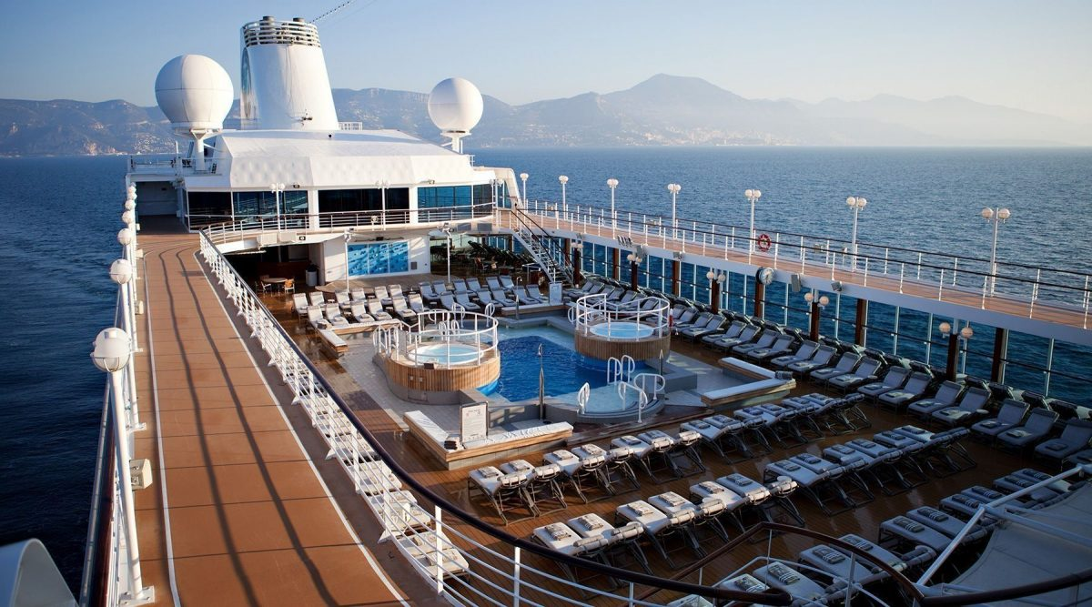 Lounge chairs surround the pool at the roof deck of Bliss Cruise's Spain/Morocco Voyage ship at sea