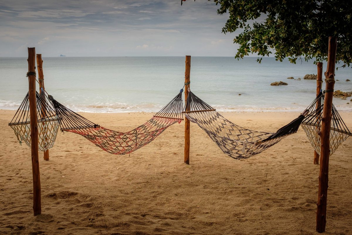 two hammocks on a beach in Koh Lanta