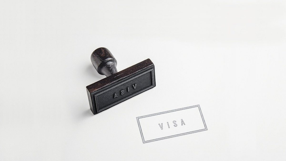 Visa stamped on white surface
