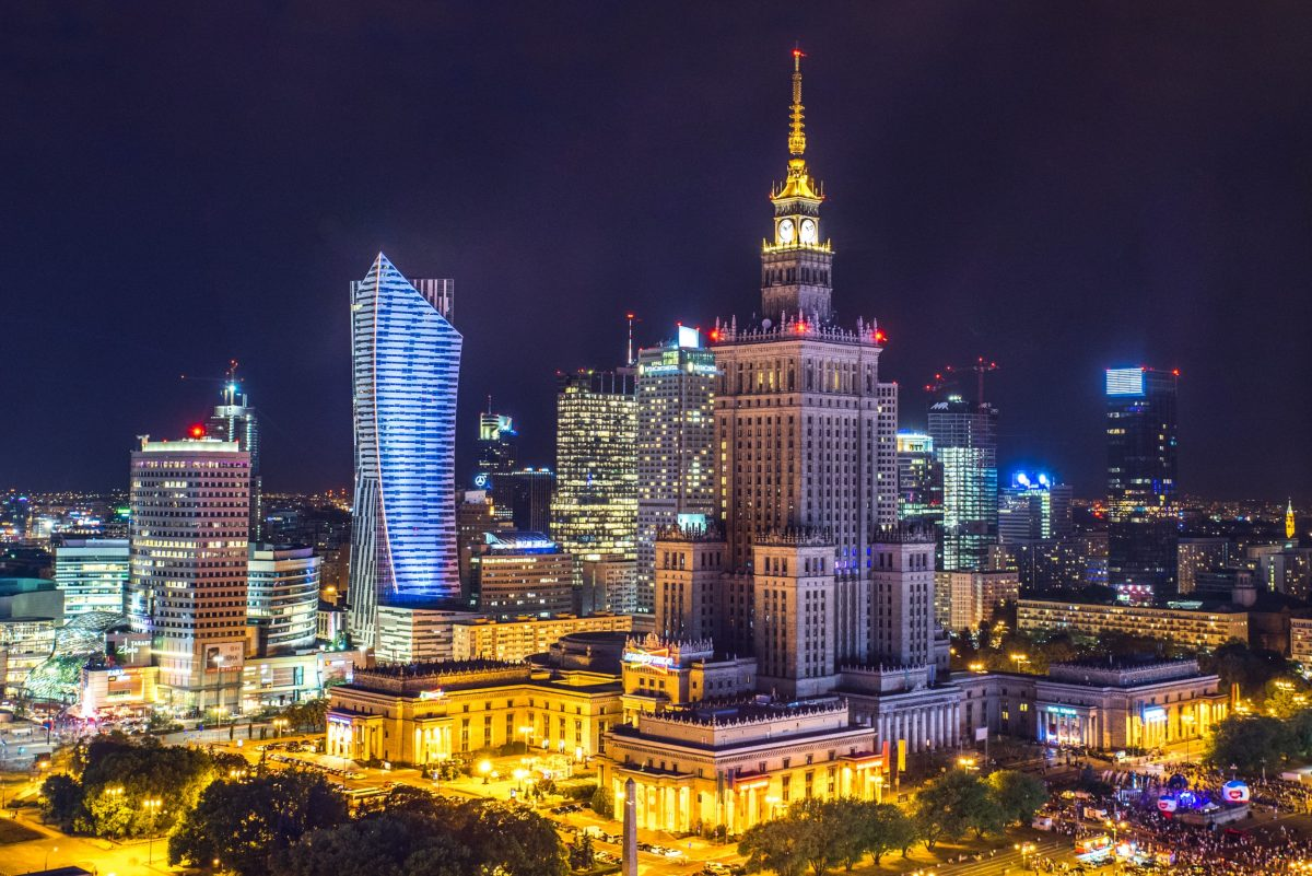 A view of brightly lit city of Warsaw at night