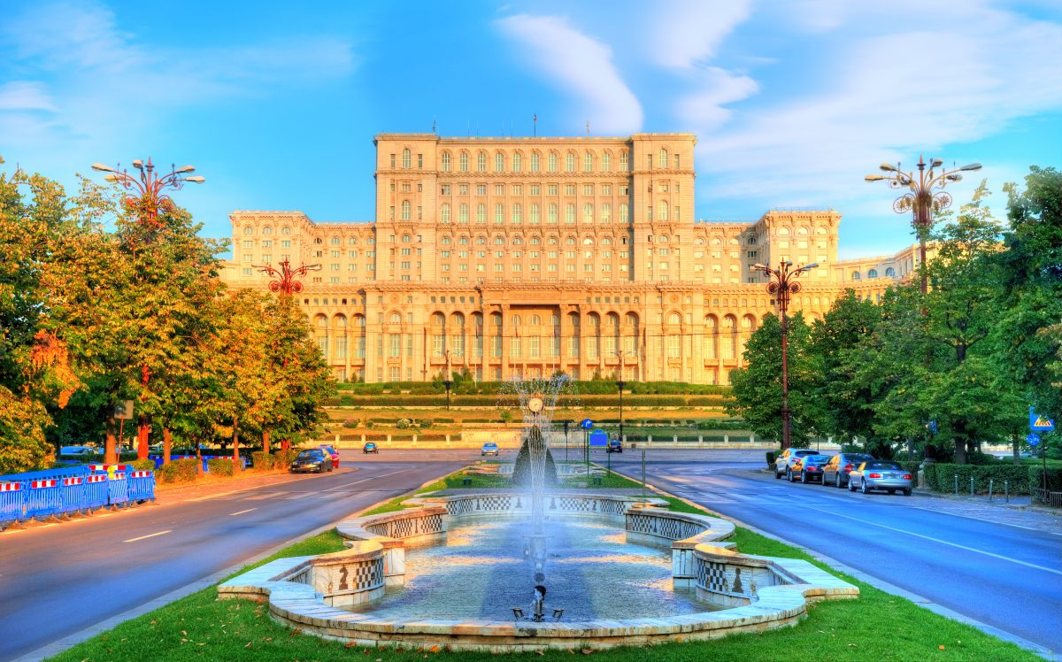 One of the famous and bigest building in the world Palace of Parliament illuminated by sunrise light in the most beautiful place of Bucharest, capital of Romania in Eastern Europe
