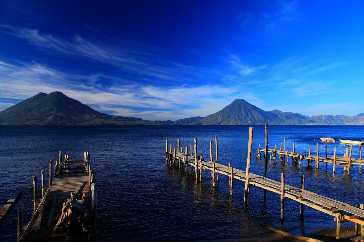 Jetties protruding out to a lake in Guatemala facing two volcanoes