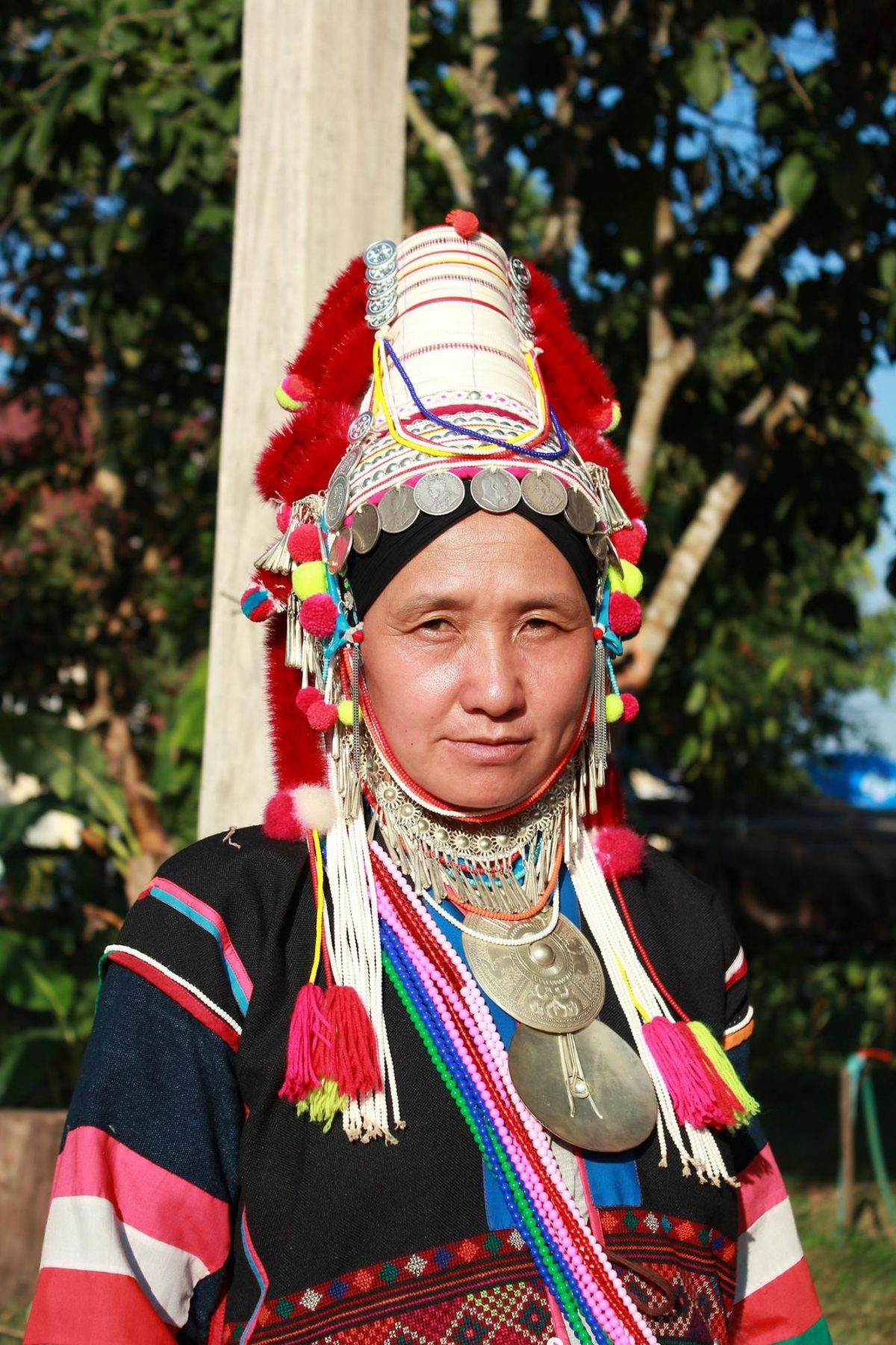 a photo a woman living in the Hill Tribe Village