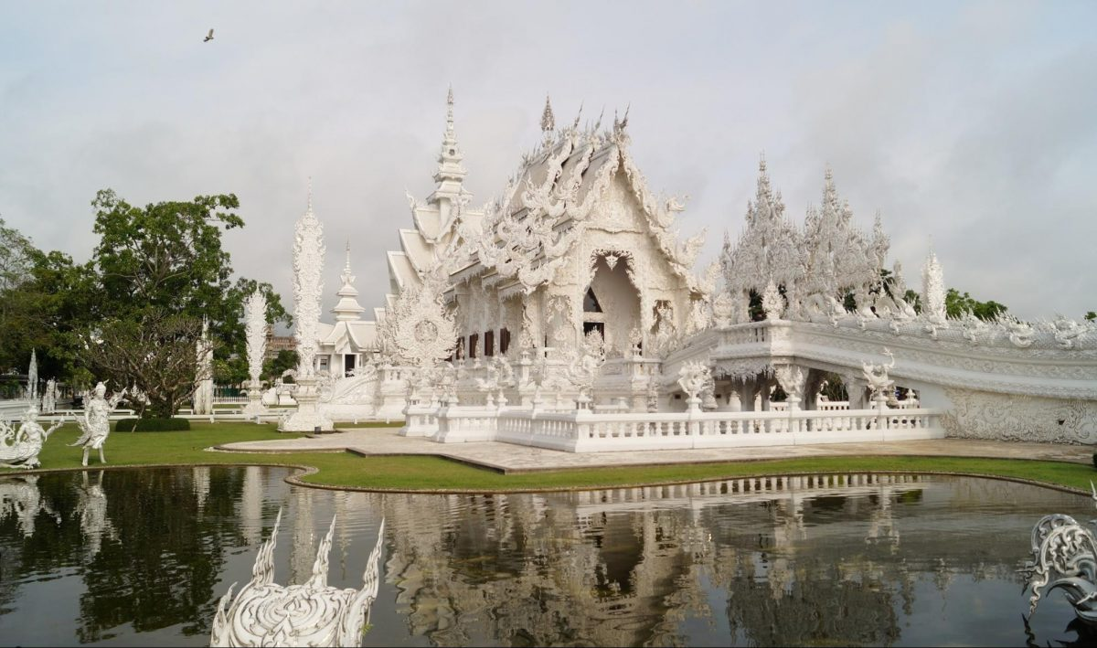 photo of the Wat Rong Khun or White Temple surrounded by the river