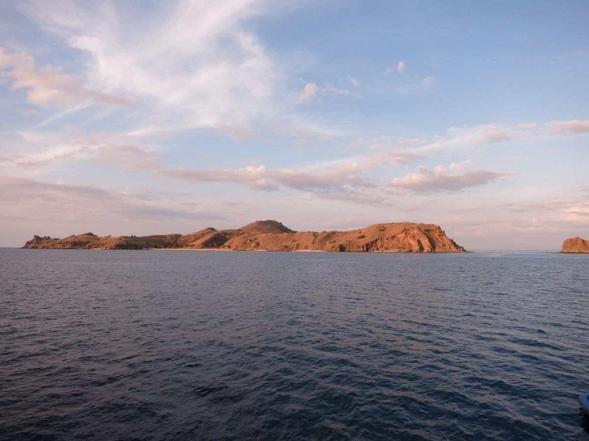 a wide angle shot of Komodo Island from far away