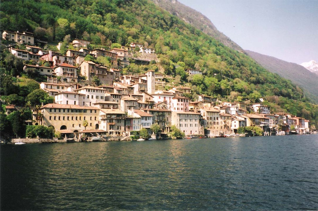 Houses on the mountain at Gandria, surrounded by Lake Lugano