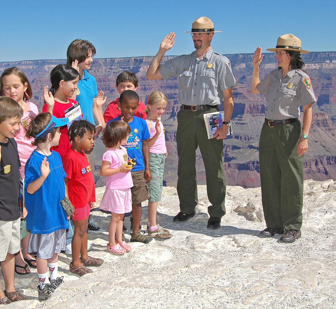 Two rangers swearing in junior rangers at the Grand Canyon