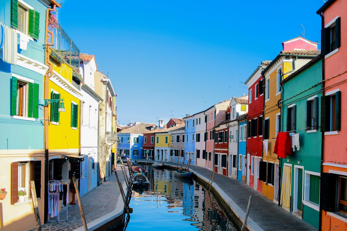 A canal street in Burano Venice with colorful buildings