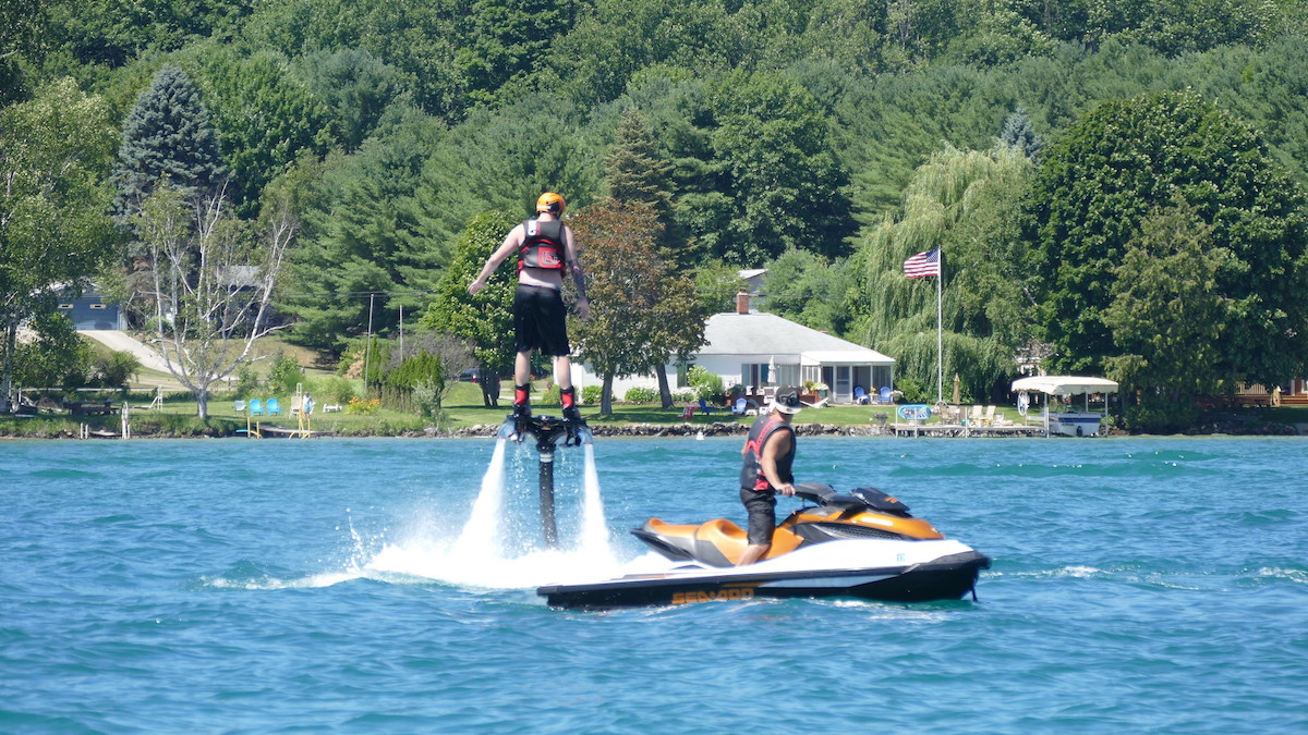 A couple of guys enjoying a jet ski ride on Lake Torch Michigan
