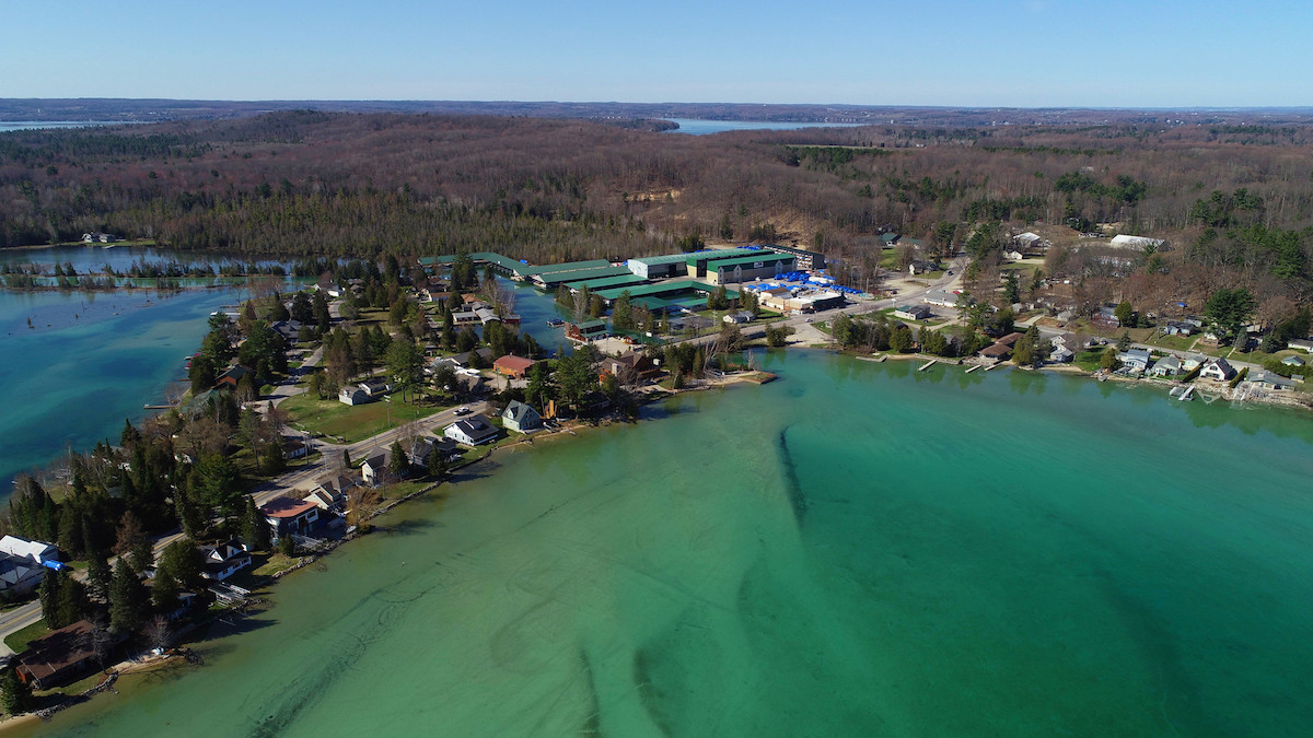 Drone view of the beautiful and crystal clear waters of Torch Lake in Michigan