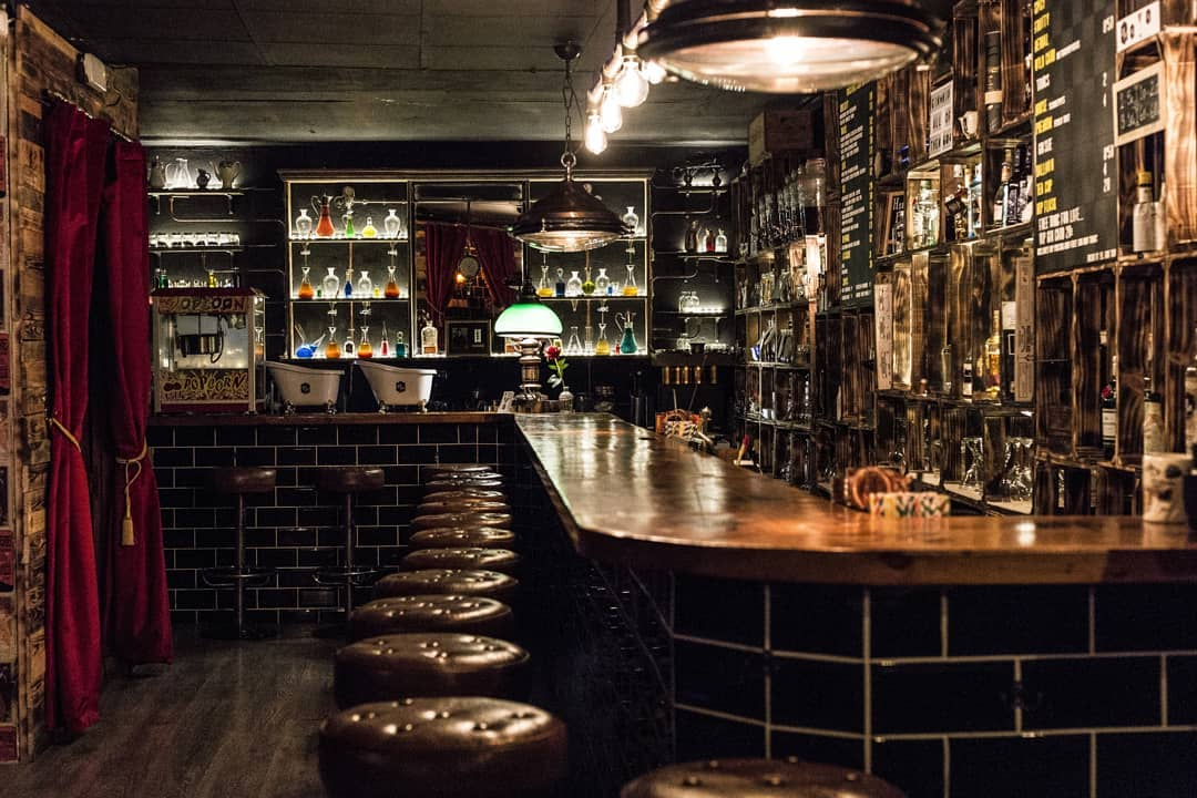 El Gin Tub club's interior design of the bar area with dark dimmed lights