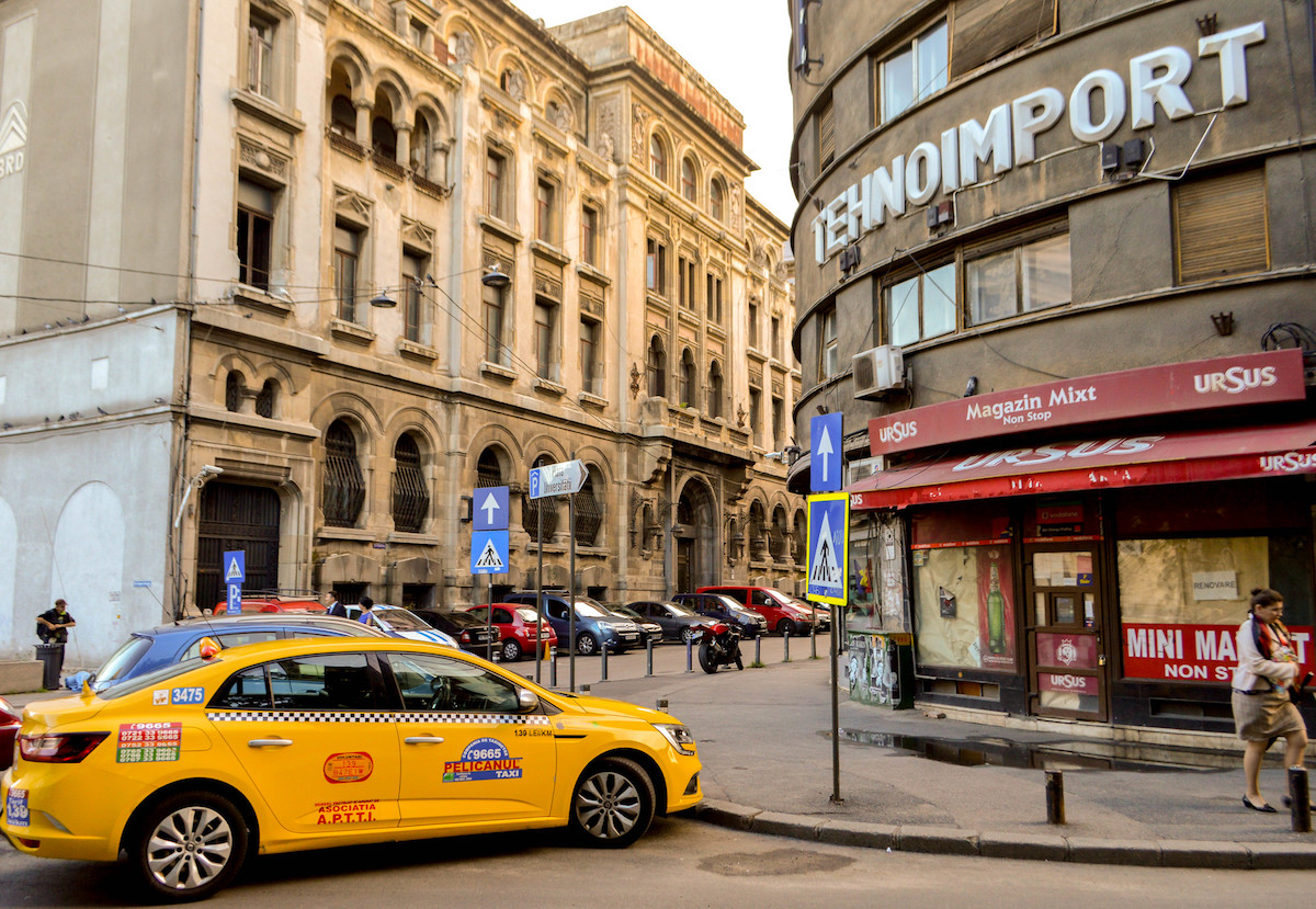 Taxis and cars line outside the Tehnoimport Building in Bucharest, Romania