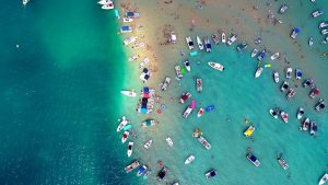 Colorful boats dotting the legendary sandbar of Torch Lake, Michigan
