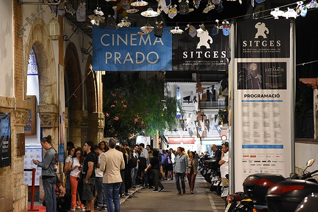 People waiting in line to get in to the theater for the Sitges Film Festival