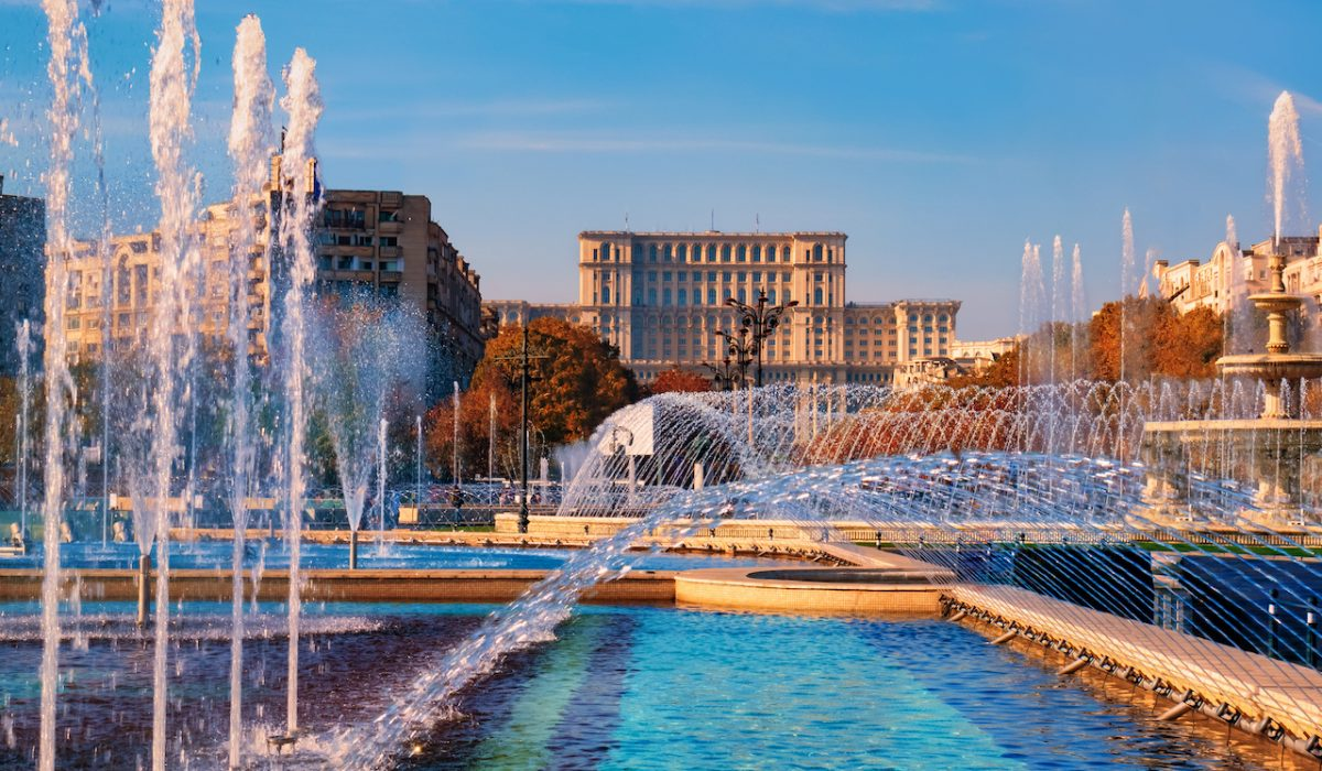 Famous building of Parliament house in Bucharest, the bigest landmark of Romania near the new fountains of Bucharest capital.