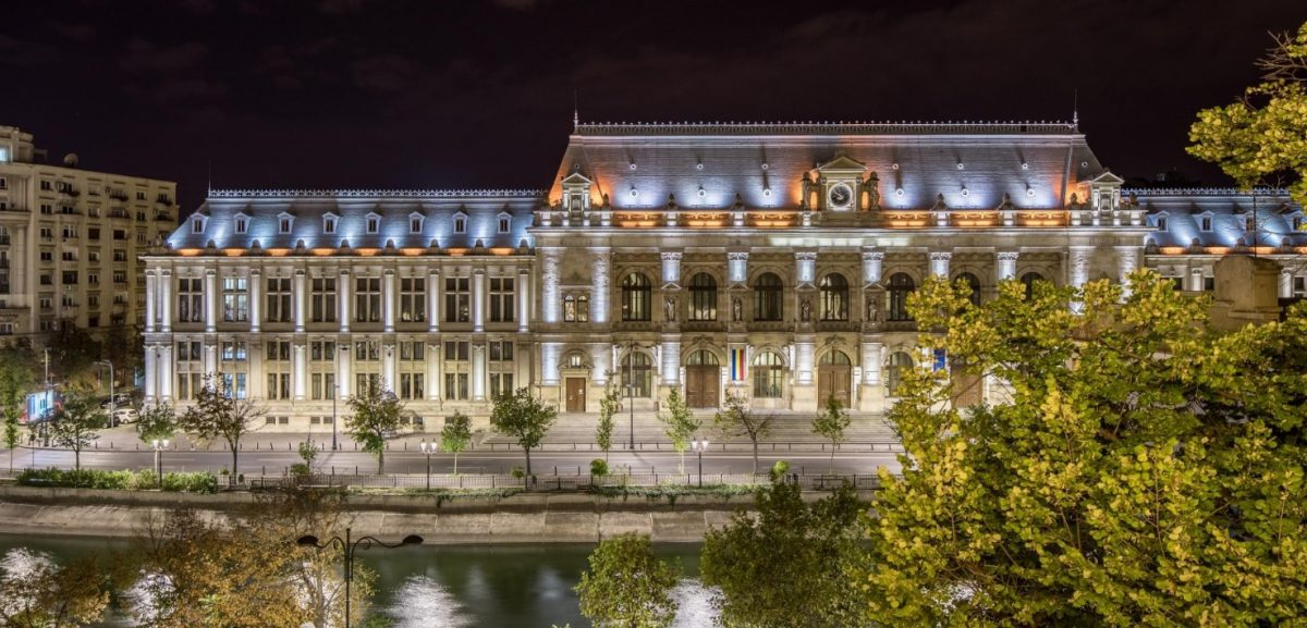 the exterior facade of Concorde Old Bucharest Hotel lit up at night