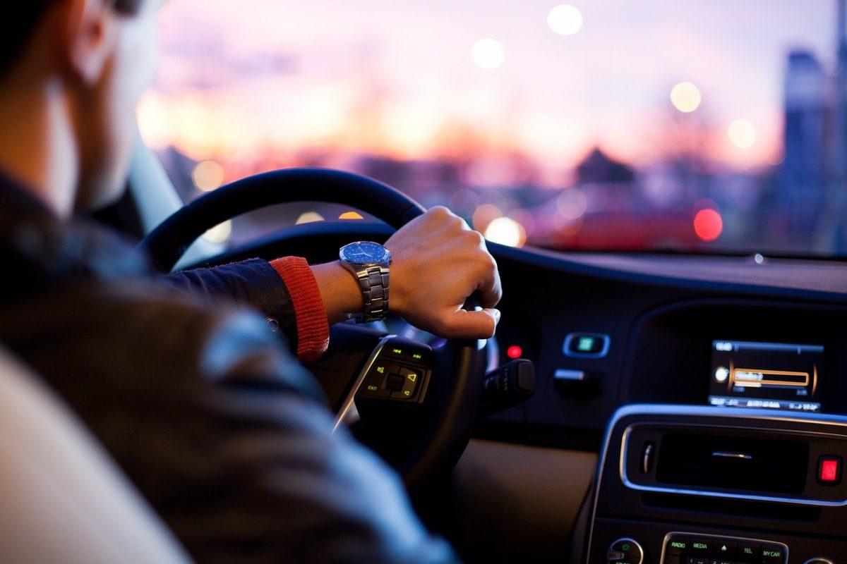 photo of a man driving a car