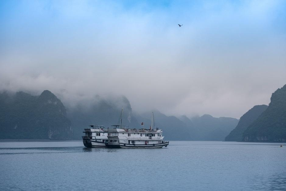 A big ferry traveling on Halong Bay