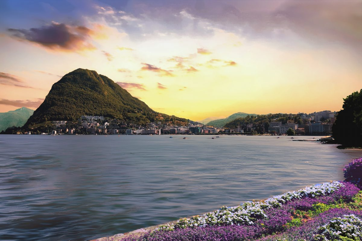 A picturesque view of a hill and town in Lugano