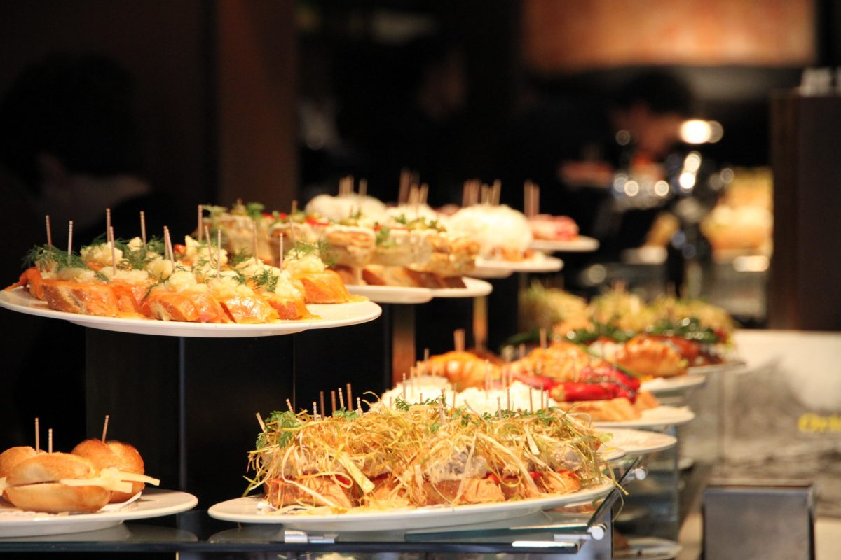 Platters of Spanish pintxos are displayed on a buffet table