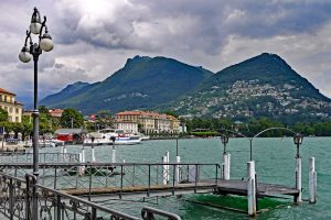 wide angle shot of the mountains and lake at Lugano Switzerland