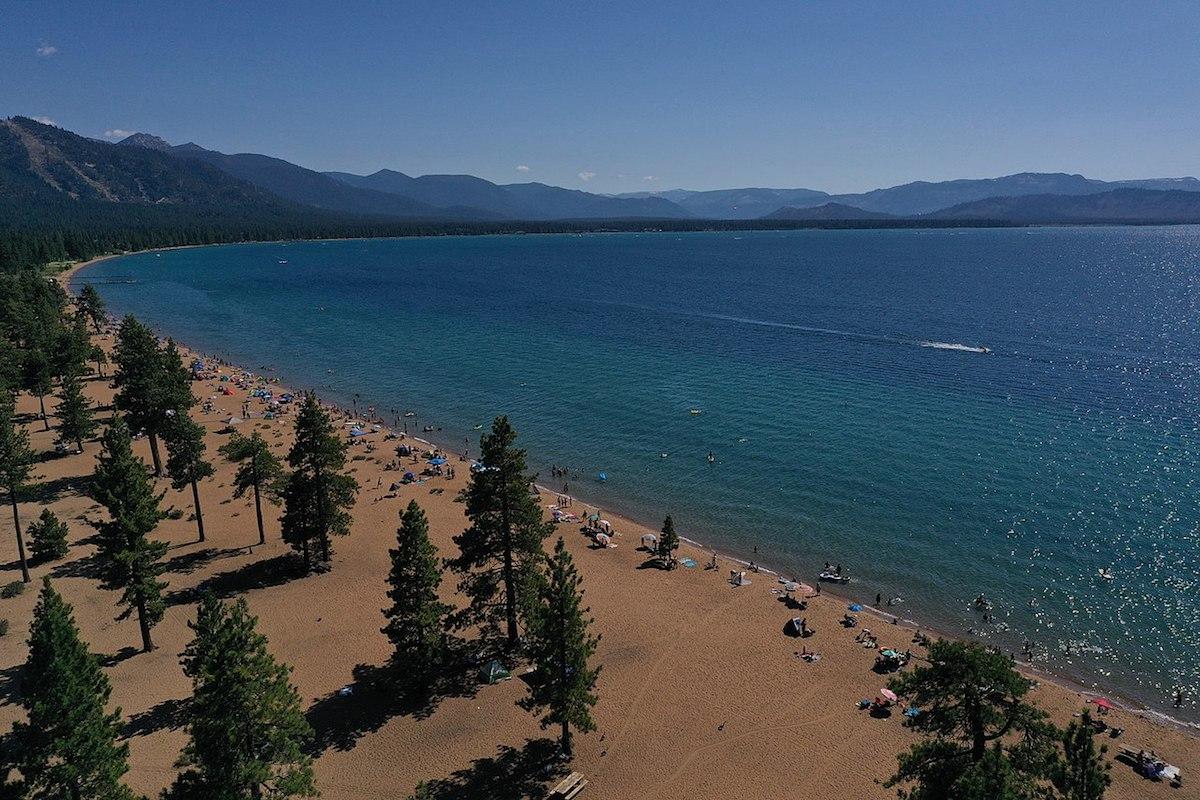 Tourists line up the long stretch of Nevada Beach shoreline