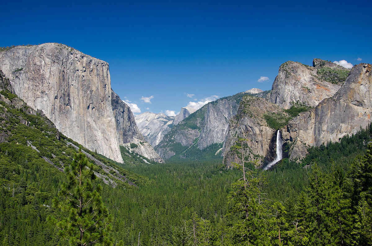 The magnificent Yosemite Tunnel View with El Capitan, Half Dome, and Bridalveil falls in the background
