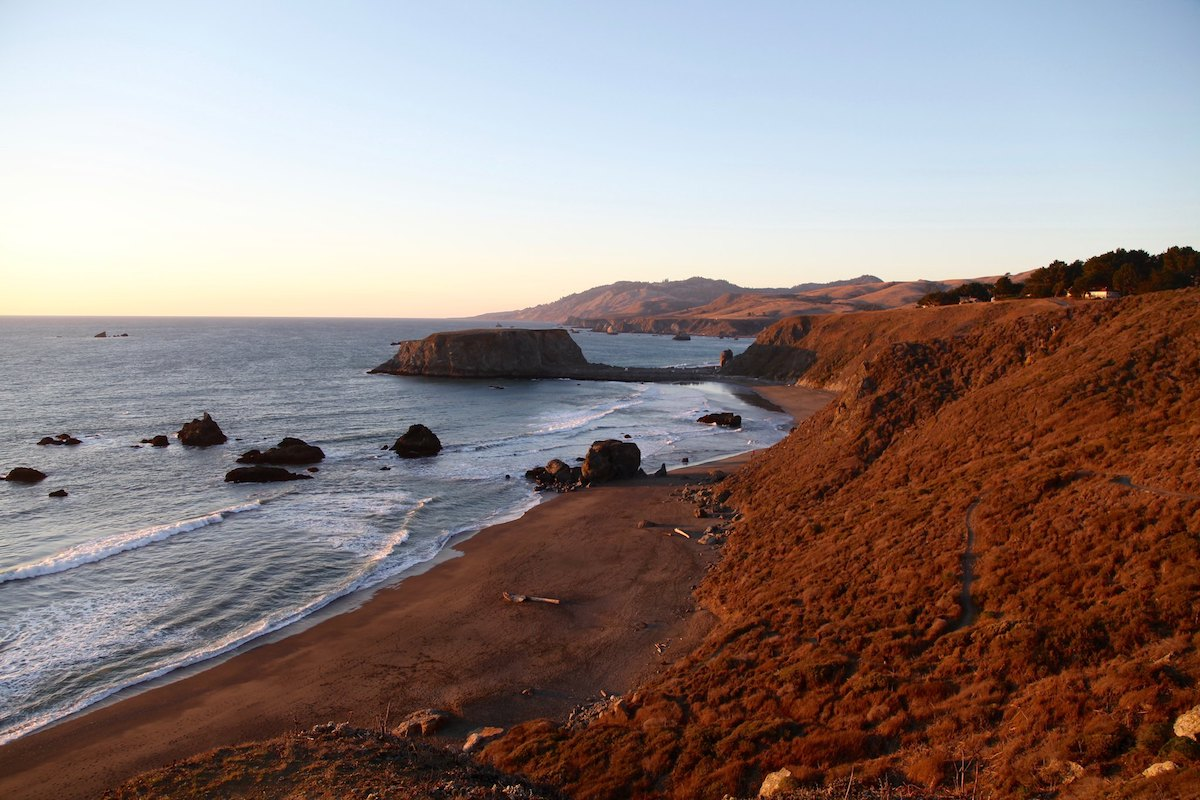 The long sandy beach and rugged headlands of Sonoma Coast State Park