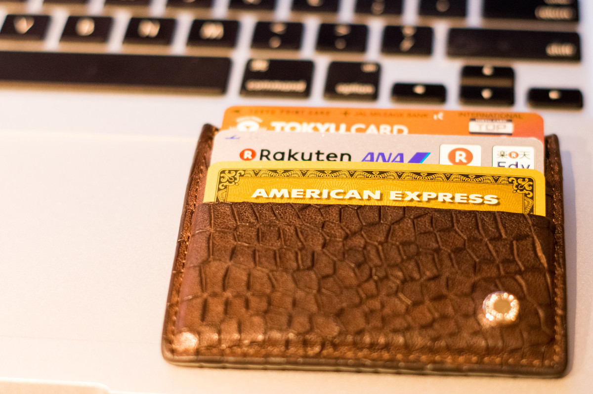 An American Express Gold Card in a wallet